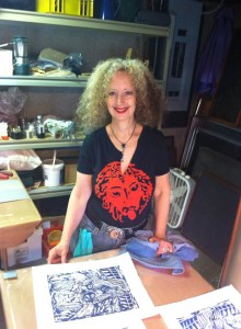 "Susan Shulman and her ""Warrior Bunny"" linocut."