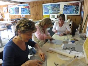 Carving lino cuts in William Evertson's studio.