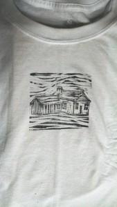 woodcut hand-printed onto a T-shirt using a rolling pin